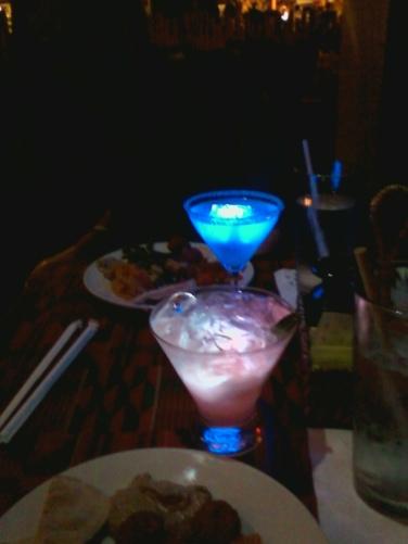 Illuminated dinner drinks on a date