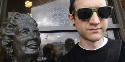 Sitting with the statue outside Barnes and Noble in downtown Naperville, IL