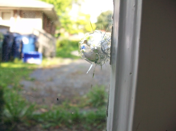 Bullethole in the window