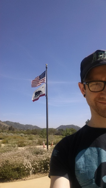 In front of flagpole in California