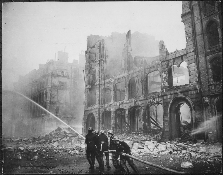 Firemen at work in London after bombing raid 1941