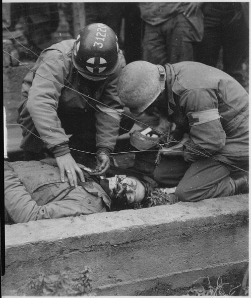 Army medics over a dying American soldier