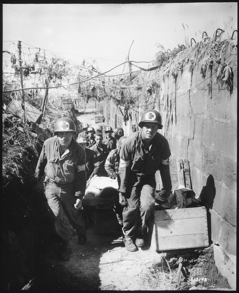 WWII Medics remove a casualty from the battlefield