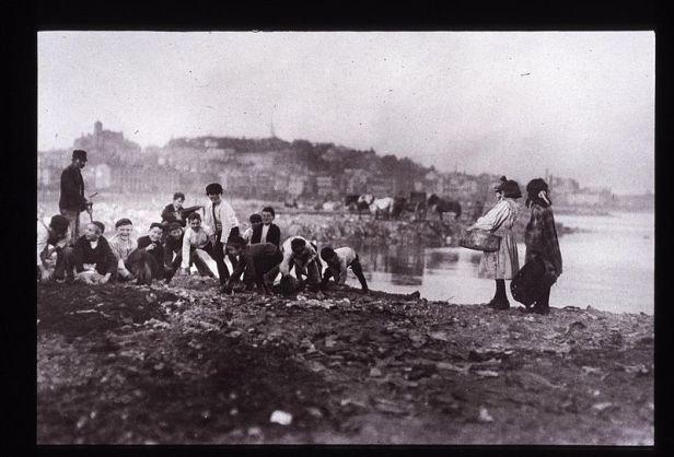 Children picking through a trash heap